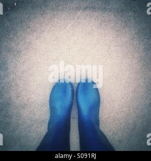 Looking down on wellies - Stock Photo
