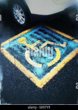 Parking space reserved for disabled drivers or drivers with disabled passengers. - Stock Photo