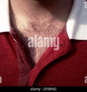 Detail of a hairy chest and red shirt - Stock Photo