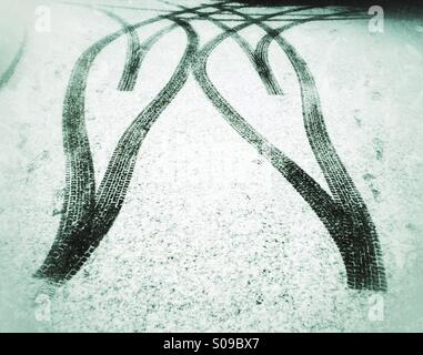 Tyre tracks in the snow forming a double heartshape. Love <3 winter! - Stock Photo