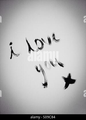 I love you written on wall in paint (black and white) - Stock Photo
