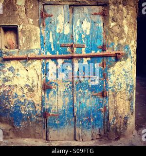 Old blue door and wall, in UNESCO world heritage town of Essaouira, Morocco. - Stock Photo