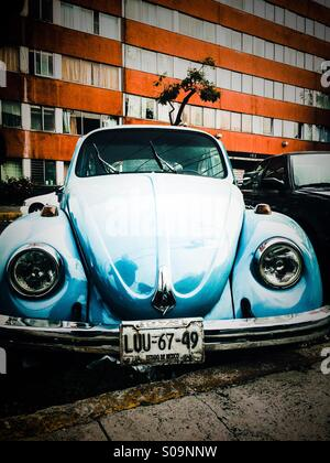 Vw beetle from the70's in an urban setup in Mexico City - Stock Photo