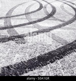 Tire tracks on snow - Stock Photo