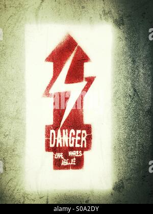 Danger, live wires above - Stock Photo