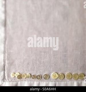 White buttons on linen - Stock Photo