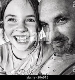 Girl with her father - black and white - Stock Photo