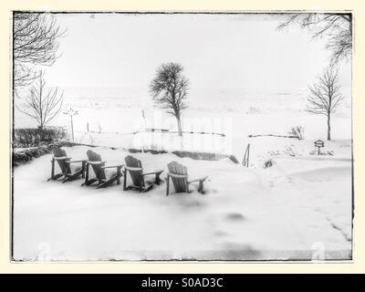 Muskoka chairs in snow - Stock Photo