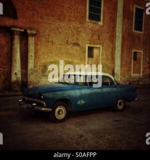 Blue vintage Cuban car parked in Habana Vieja. Havana, Cuba. - Stock Photo