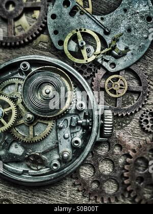 Old pocket watches and gears. - Stock Photo