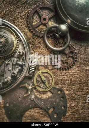 Old pocket watches and parts. - Stock Photo