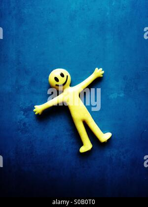 Smiley face rubber toy - Stock Photo