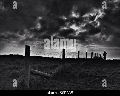 Cliff top silhouette - Stock Photo