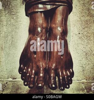 Wooden carving of the feet of Christ - Stock Photo