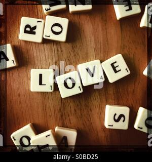 The word LOVE spelled out in gaming tiles - Stock Photo