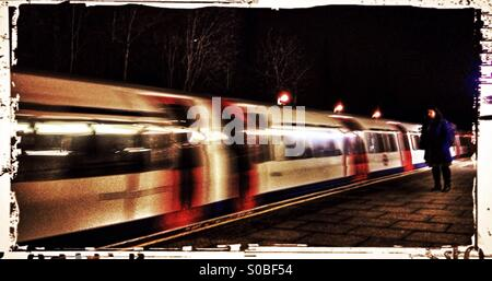 Piccadilly line train at night, Sudbury Hill underground station, London Borough of Harrow, North West London, England, - Stock Photo