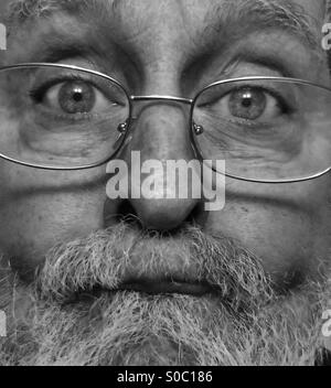 White male, age 64, close-up of bearded, aging face, Model Released, black and white - Stock Photo