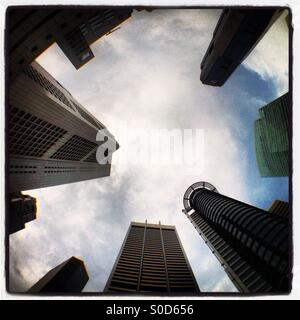 Skyscrapers viewed from Raffles Place, in the Central Business District in Singapore - Stock Photo