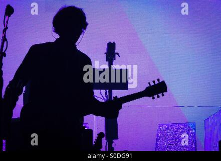 Silhouette of Tim Carter of Kasabian at Brixton Academy 4th December 2014. - Stock Photo