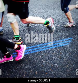 Follow the blue line. Virgin Money London Marathon 2015 - Stock Photo