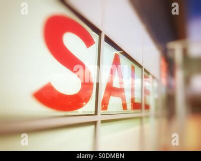 Sale sign in a shop window - Stock Photo