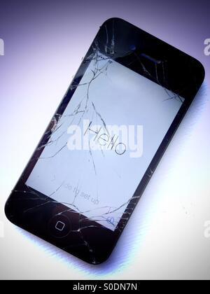 iPhone 4S with broken screen - Stock Photo