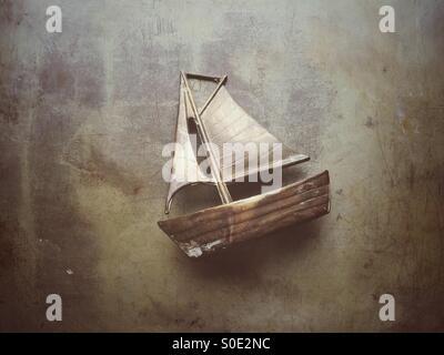 Old metal sailing boat model - Stock Photo