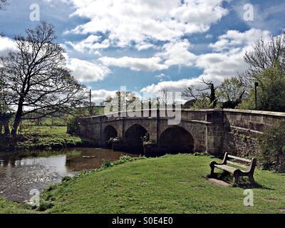 Stone bridge over the river Manifold in the village of Ilam, Staffordshire - Stock Photo