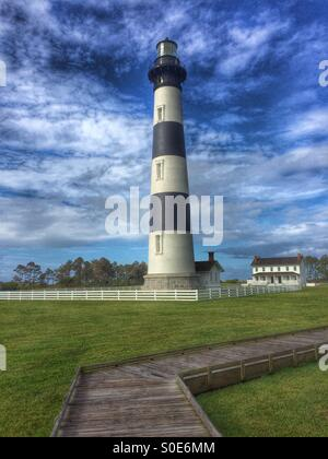 An early morning view of the Bodie Island lighthouse and adjacent boardwalk in Nags Head in Cape Hatteras National - Stock Photo