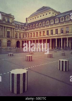 View of main courtyard at Place du Palais-Royal in Paris, France. Les Deux Plateaux installation by Daniel Buren - Stock Photo