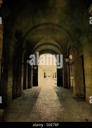 Arcade view of entrance to the galleries of the Place du Palais-Royal in the historic centre of Paris, France. Antique, - Stock Photo
