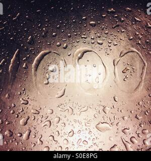 Title '1000' with water drops on metal surface - Stock Photo