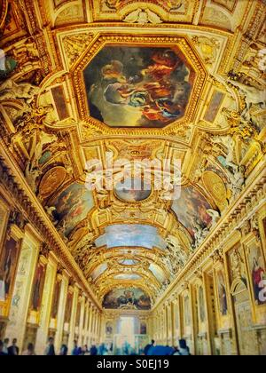 The golden Galerie d'Apollon famous for its high vaulted ceilings with painted decorations and stucco sculptures. - Stock Photo