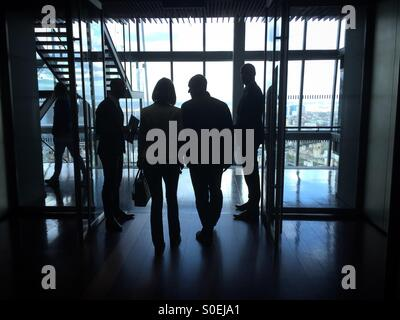 Silhouettes of business people in the shard - Stock Photo
