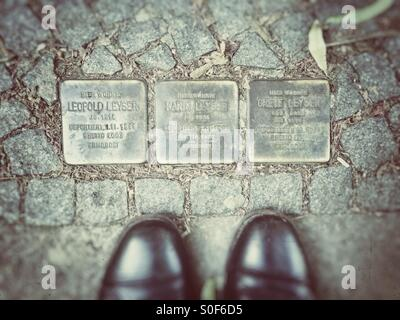 Looking down At Memorial Stones for jews murdered in the Shoa in the pavement of the sidewalk of the House were - Stock Photo