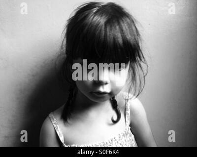 Unhappy 3-year old girl - Stock Photo