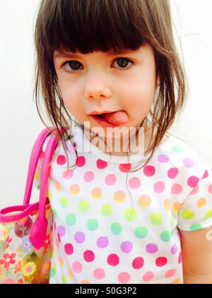3-year old girl wearing colourful dress - Stock Photo