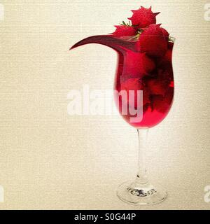 Surreal manipulated image showing strawberries and juice in a tall glass. - Stock Photo