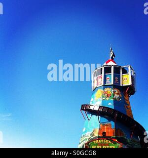 Traditional Helter Skelter against a deep blue sky - Stock Photo