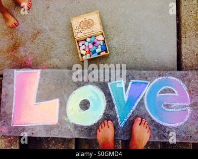 Chalk drawing of love - Stock Photo