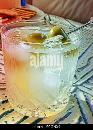 Martini on the rocks with olives in a crystal glass tumbler - Stock Photo