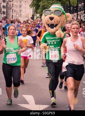 Happy Lion running in the British 10k Run London - Stock Photo