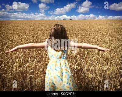 Girl in Cornfield - Stock Photo