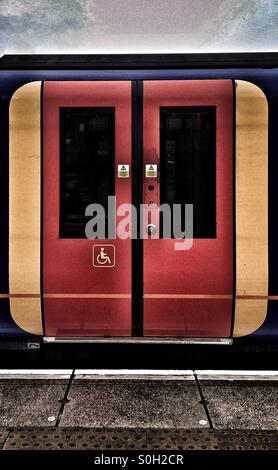 Disabled sign on the sliding doors of a Southwest Trains carriage - Stock Photo
