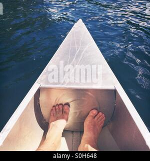 Two feet in a canoe - Stock Photo