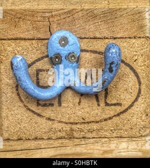 Blue vintage coat hook in a Mexican restaurant - Stock Photo