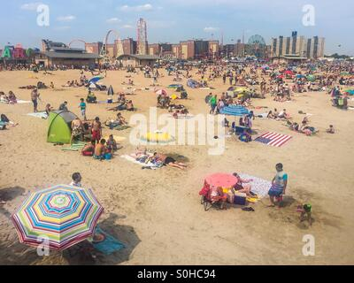 Coney Island beach in the summer. - Stock Photo