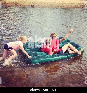 Children having fun on the river - Stock Photo