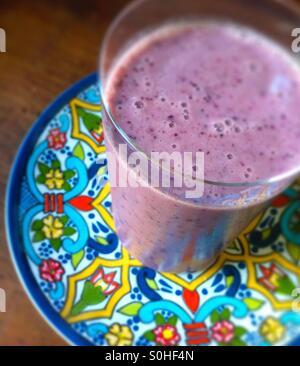 Almond milk berry papaya smoothie - Stock Photo