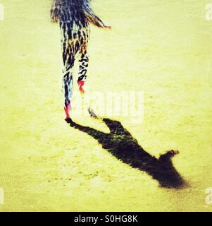 Running barefoot in a onesie - Stock Photo